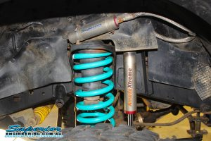 Closeup view of a single heavy duty Dobinson coil spring fitted to the front of a 80 Series Toyota Landcruiser wagon