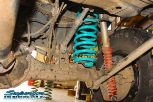 Closeup view of a single heavy duty Dobinson coil spring fitted to the rear of a 80 Series Toyota Landcruiser wagon