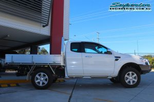 Right side view of a white Ford Ranger PX11 (Extra Cab) fitted with a basic 40mm lift kit by Superior Engineering