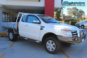 Front right view of a white Ford Ranger PX11 (Extra Cab) fitted with a basic 40mm lift kit at the Superior Engineering Deception Bay 4wd retail store