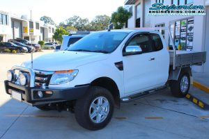 Front left view of a white Ford Ranger PX11 (Extra Cab) fitted with a basic 40mm lift kit at the Superior Engineering Deception Bay 4wd retail showroom