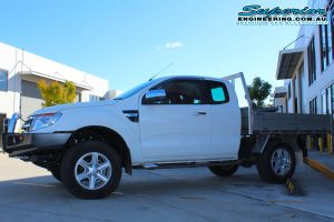 Left side view of the white Ford Ranger PX11 (Extra Cab) fitted with a basic 40mm lift kit at the Superior Engineering Deception Bay 4wd retail showroom