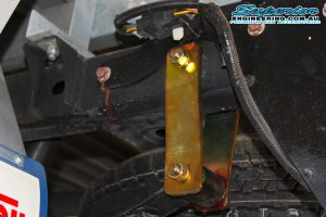 A Superior extended greaseable shackle fitted to the rear leaf spring and chassis on the Ford Ranger PX11 (Extra Cab) on the hoist at the Superior Engineering Deception Bay 4wd workshop