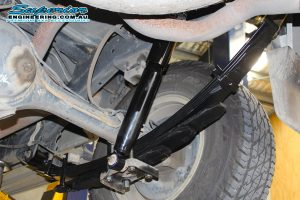 Closeup view of a single EFS shock absorber, leaf springs and u-bolts fitted to the rear of the Isuzu D-Max 4wd