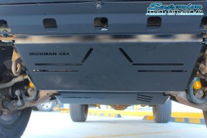 Closeup view of an Ironman 4x4 Engine Bay and Transmission Guard to a dual cab Mitsubishi Triton four wheel drive vehicle at the Deception Bay Retail Store
