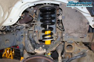 Closeup view of a single Bilstein shock and coil spring fitted to the front of the dual cab Mitsubishi Triton four wheel drive vehicle at the Deception Bay Retail Store