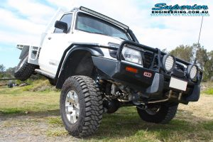 Front View - Testing out the rear flex on the GU Nissan Patrol ute with the forklift after being fitted with a complete Superior Engineering 4WD suspension fitout at their main Burpengary warehouse