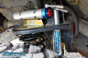 Closeup view of a single premium Superior Remote Reservoir Shock fitted to the reservoir mount fixed to the shock tower on the GU Nissan Patrol Ute