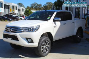 Front left view of a brand new white Toyota Hilux Revo (dual cab) after being fitted with a 2 inch Bilstein lift kit at the Superior Engineering Deception Bay 4WD Retail Store