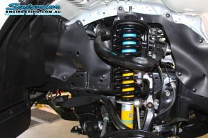 Closeup view of a single Bilstein strut and coil spring fitted to the front of a new Toyota Hilux Revo four wheel drive
