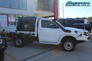 Right side view of a single cab Toyota Hilux Revo fitted with a 2 inch Bilstein lift kit, Dual air control kit and Airbag Man leaf spring helper kit