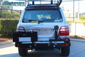 Rear end view of the IFS 100 Series Toyota Landcruiser fitted with an MCC4x4 Rear Bar with Wheel Carrier and Dual Jerry Can Holder