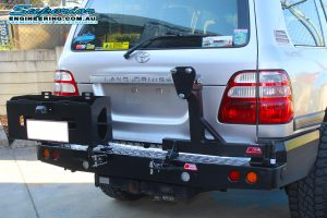 Closeup view of the MCC4x4 Rear Bar with Wheel Carrier and Dual Jerry Can Holder fitted to the rear of the IFS 100 Series Toyota Landcruiser