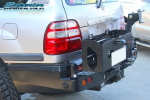 Closeup side view of the MCC4x4 Rear Bar with Wheel Carrier and Dual Jerry Can Holder fitted to the rear of the IFS 100 Series Toyota Landcruiser