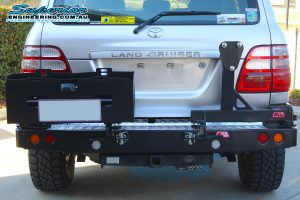 Full rear view of the MCC4x4 Rear Bar with Wheel Carrier and Dual Jerry Can Holder fitted to the rear of the IFS 100 Series Toyota Landcruiser