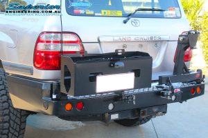 Rear view of the MCC4x4 Rear Bar with Wheel Carrier and Dual Jerry Can Holder fitted to the rear of the IFS 100 Series Toyota Landcruiser wagon