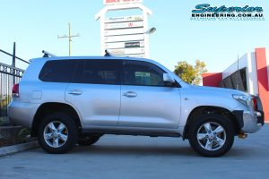 Right side view of a silver 200 Series Toyota Landcruiser wagon fitted with a premium 2 inch Superior Adjustable Remote Reservoir Lift Kit