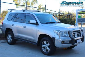 Front right view of a silver 200 Series Toyota Landcruiser wagon fitted with a premium 2 inch Superior Adjustable Remote Reservoir Lift Kit in the car park at the Deception Bay 4wd retail showroom