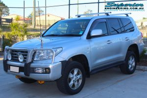 Front left view of a silver 200 Series Toyota Landcruiser wagon fitted with a premium 2 inch Superior Adjustable Remote Reservoir Lift Kit in the car park at the Deception Bay 4wd retail showroom