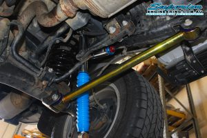 Closeup view of a heavy duty superior rear lower control arm, coil spring and remote res shock fitted to the rear of the 200 Series Toyota Landcruiser
