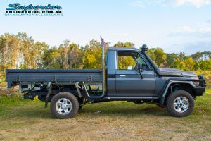 Right side view of a 79 Series Toyota Landcruiser fitted out with a full rear coil conversion kit and rear track width correction system