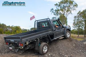 Testing out the 79 Series Toyota Landcruiser on some mounds after being fitted with a full coil conversion kit and rear track width correction system at Superiors Burpengary workshop