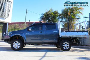 Left side view of a Grey dual cab Isuzu D-Max four wheel drive ute after being fitted with a range of 4x4 accessories and a new suspension system