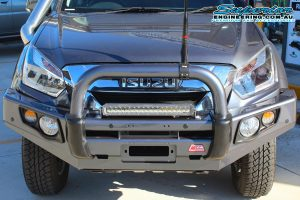 Closeup front view of the dual cab Isuzu D-Max four wheel drive ute after being fitted with a black MCC4x4 Falcon Bullbar, 28 inch Ironman LED Lightbar and GME antenna at the Superior Engineering 4wd retail showroom