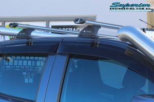 Closeup view of the dual cab Isuzu D-Max fitted with a Whispbar HD Roof Bar System at the Superior Engineering 4wd retail showroom