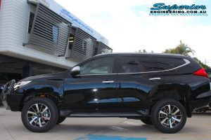 Left side view of a Black Mitsubishi Pajero Sport Wagon fitted with a 40mm Ironman 4x4 Lift Kit
