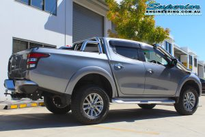Rear right end view of a grey MQ Mitsubishi Triton dual cab ute after being fitted with a 40mm Bilstein lift kit at the Superior Engineering 4x4 retail showroom
