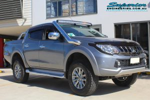 Front right view of a grey MQ Mitsubishi Triton dual cab ute after being fitted with a 40mm Bilstein lift kit at the Superior Engineering 4x4 workshop