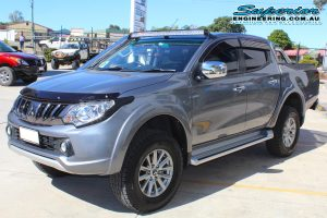Front left view of a grey MQ Mitsubishi Triton dual cab ute after being fitted with a 40mm Bilstein lift kit at the Superior Engineering 4x4 workshop