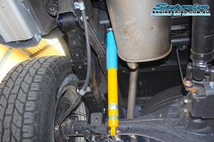 Closeup view of a single EFS leaf spring and Bilstein shock fitted to the rear of a dual cab MQ Mitsubishi Triton