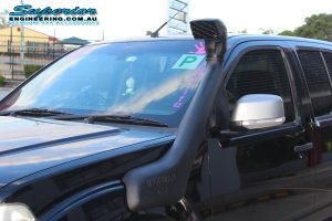 Closeup view of an Ironman 4x4 snorkel fitted to a Nissan Navara D40 Dual Cab