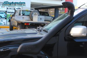 Closeup view of an Ironman 4x4 snorkel fitted to a Nissan Navara D40 Dual Cab at the Superior 4x4 Retail Showroom