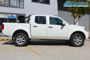 Right side view of a white Nissan Navara D40 dual cab after being fitted with a 2 inch Bilstein lift kit