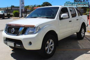 Front left view of a white Nissan Navara D40 dual cab after being fitted with a 2 inch Bilstein lift kit at the Superior Deception Bay 4x4 retail showroom