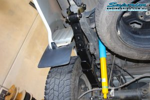 Closeup view of a single EFS leaf spring, greaseable shackle and Bilstein shock fitted to the rear of a Nissan Navara D40 Dual Cab