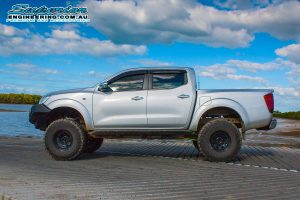 Left side view of an NP300 Nissan Navara (dual cab) after fitting a suspension kit by Superior Engineering
