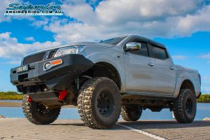 Front left view of the silver NP300 Nissan Navara (dual cab) after fitting a heavy duty lift kit by Superior Engineering