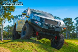 Front view of the silver NP300 Nissan Navara (dual cab) after fitting the big lift kit then testing out the flex on some mounds at the Superior Engineerings Burpengary warehouse