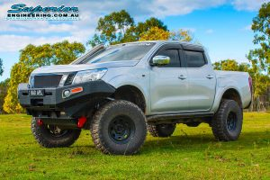 Left side view of the Bad Apple - NP300 Nissan Navara (dual cab) after fitting a Superior lift kit at the Superior Engineering Burpengary warehouse