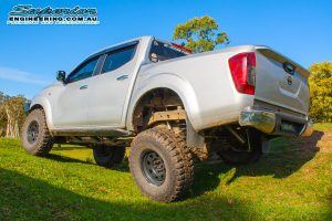 Left rear end view of the Bad Apple - NP300 Nissan Navara (dual cab) after fitting a lift kit at the Superior Engineering Burpengary warehouse