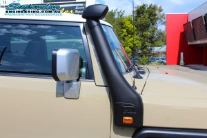 Closeup view of a Toyota FJ Cruiser fitted with a TJM Airtec Snorkel at the Deception Bay 4x4 Super Showroom