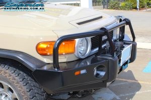 Closeup view of a Toyota FJ Cruiser fitted with an Ironman 4x4 Black Commercial bullbar at the Deception Bay 4WD Retail Showroom