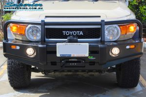 Front closeup view of the Ironman 4x4 Black Commercial Bullbar fitted to the Toyota FJ Cruiser at the Deception Bay 4WD Retail Showroom