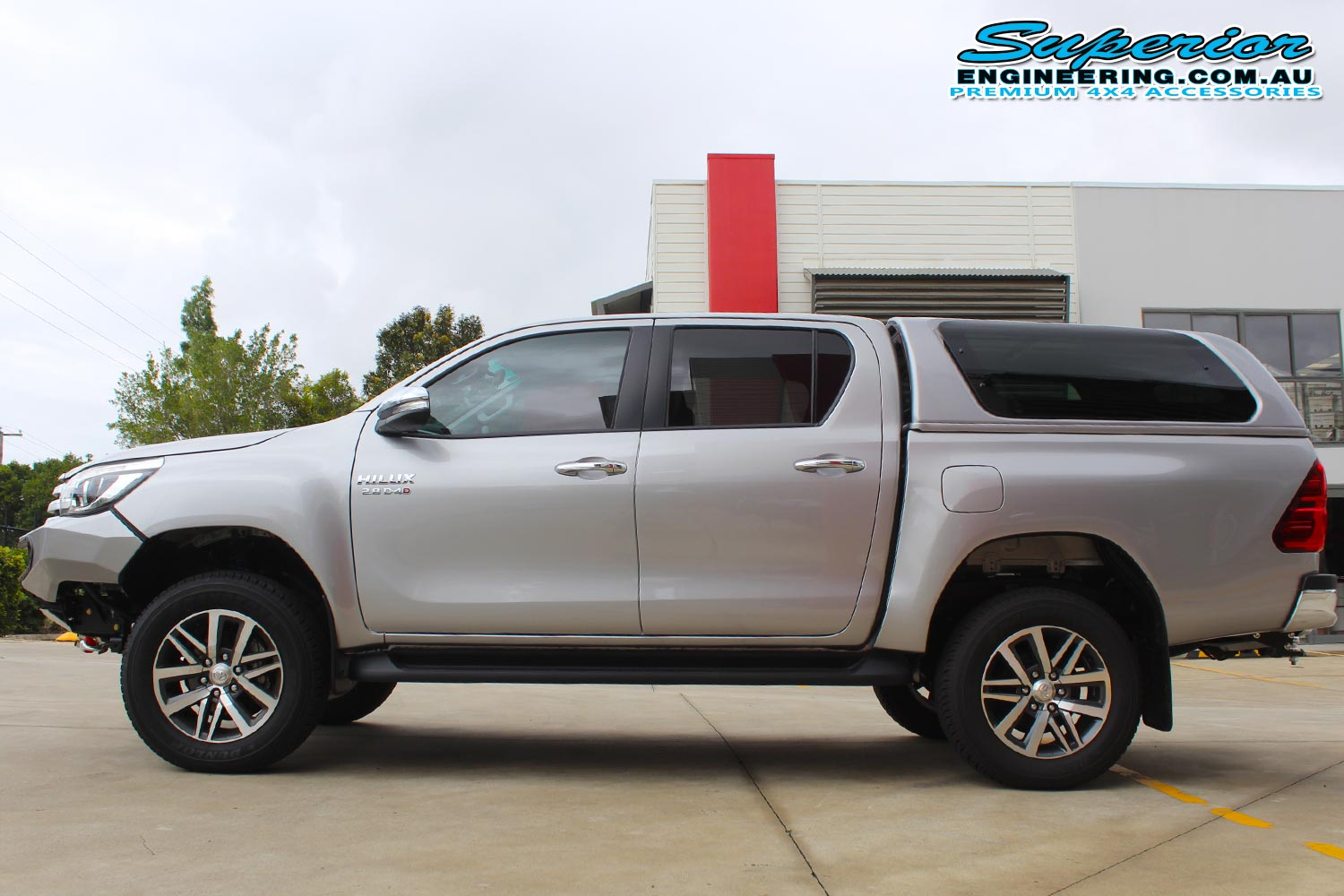Left side view of a Silver Toyota Hilux Revo (dual cab) after being fitted with a top of the range 2 inch Bilstein lift kit at the Superior Engineering Deception Bay 4WD Workshop
