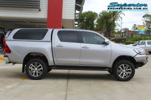 Right side view of a Silver Toyota Hilux Revo (dual cab) after being fitted with a top of the range 2 inch Bilstein lift kit at the Superior Engineering Deception Bay 4WD Workshop