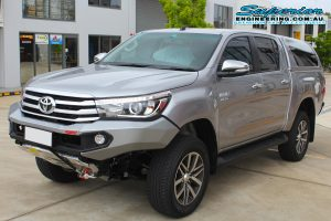 Front left view of the Silver Toyota Hilux Revo after being fitted with a 2 inch Bilstein lift kit at the Superior Engineering Deception Bay car park